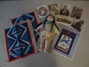 Native American leggings, doll, ledger book and post cards
