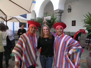 Rachel Roberts poses with a pair of native Ecuadorans while visiting South America for six months.