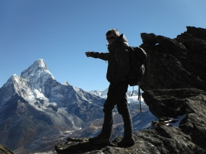 Cody Cavill surveys the Himalayan landscape while visiting their to conduct a climbing school for natives of the region.