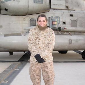 Bozeman native Grace Denk stands in front of a helicopter in Afghanistan.