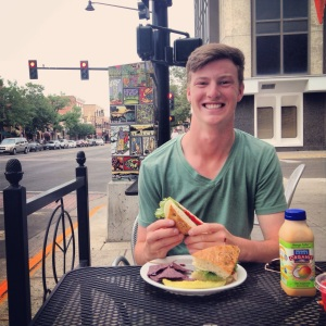 Montana State University student Connor Brooks enjoys a meal at an outside eatery in downtown Bozeman.